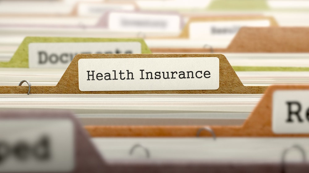 Health Insurance - Folder Register Name in Directory. Colored, Blurred Image. Closeup View..jpeg