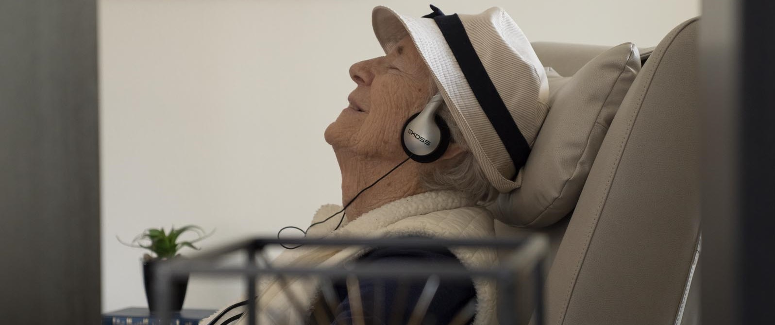 older adult with headphones
