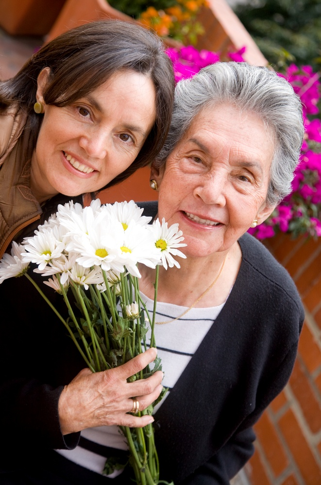 mother and daughter portrait outdoors with flowers.jpeg