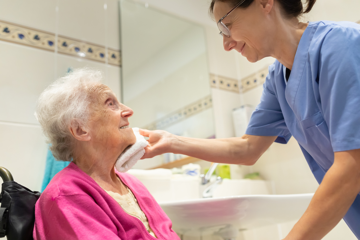 Nurse caring for a senior living resident